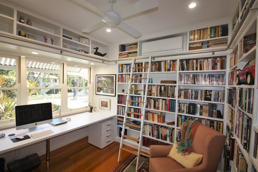 home office library with desk and library ladder