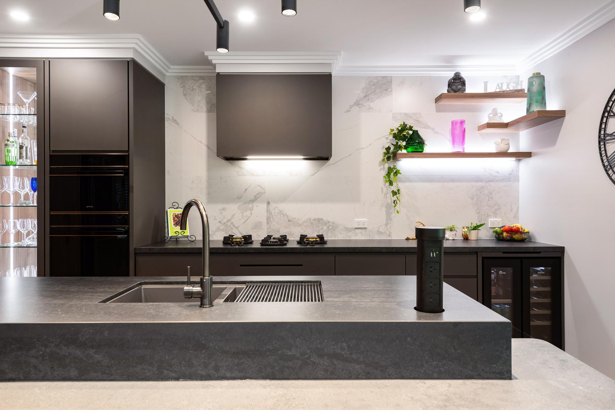 Modern industrial kitchen, concrete look benchtops, marble tile splashback, timber shelves, feature lighting