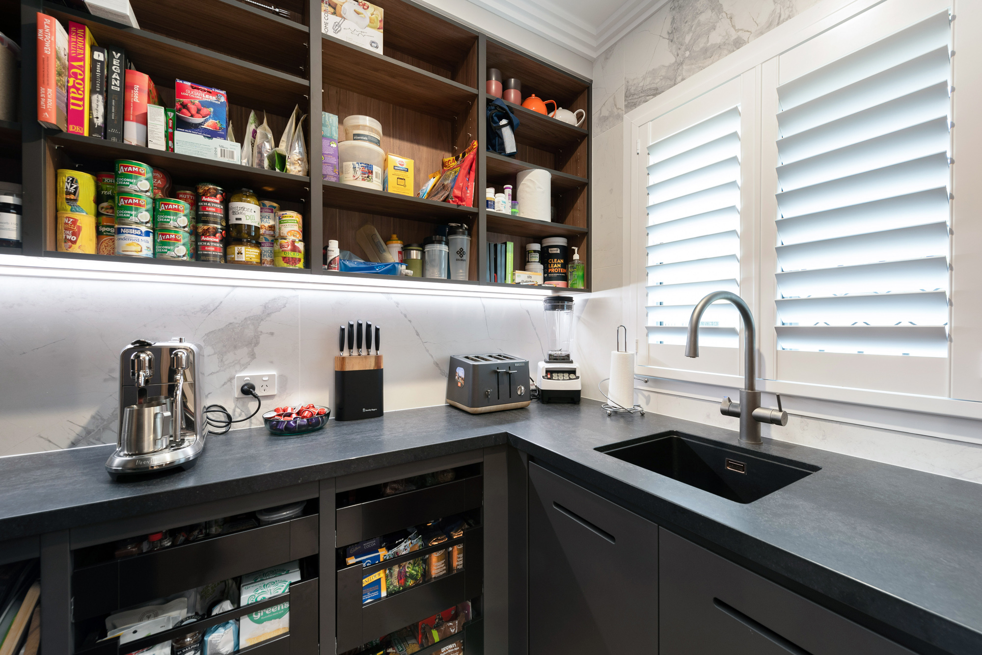 Industrial style Black and timber butlers pantry with marble splashback