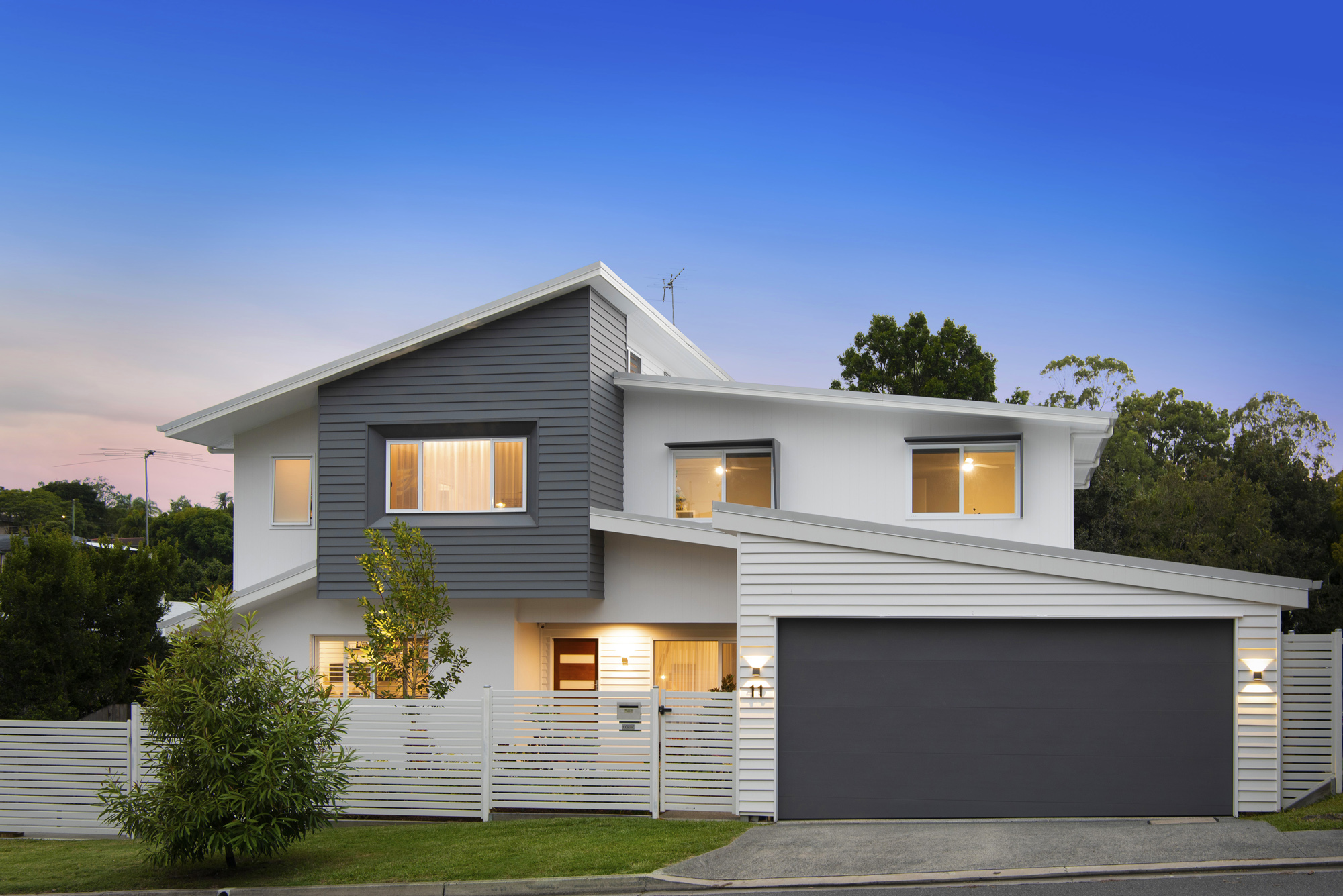 Dusk photo, lights in windows, front facade, modern second storey extension